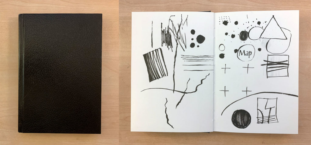 A hardbound black sketchbook closed and opened
