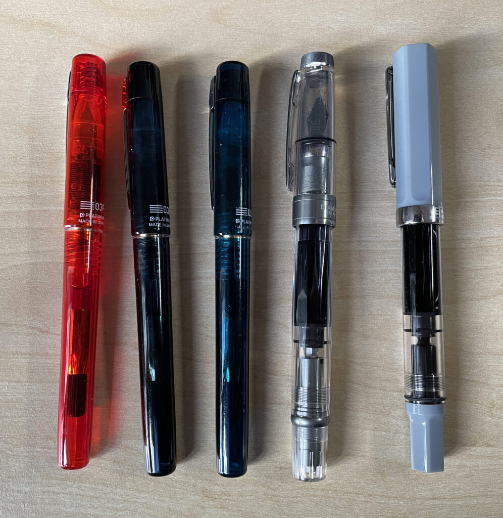 A picture showing five fountain pens.